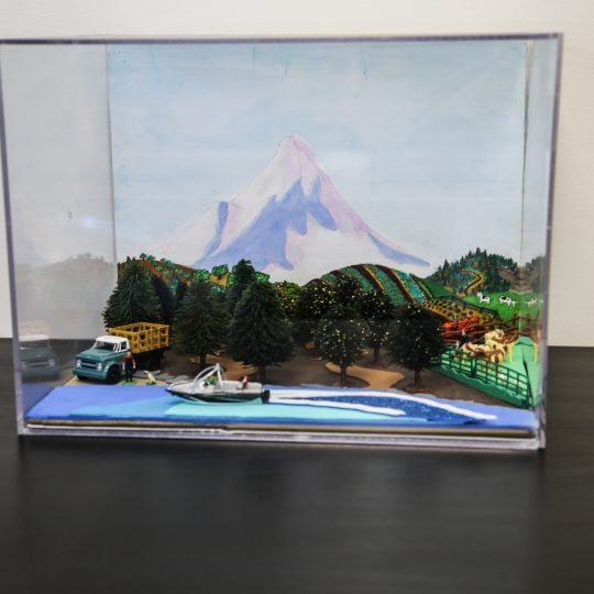 Forced perspective diorama in a clear case that represents some of Oregon's agriculture.